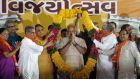 Bharatiya Janata Party's prime ministerial candidate and Gujarat chief minister Narendra Modi is greeted by huge garland. Photograph : Divykant Solanki/EPA
