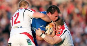 Leinster's Rhys Ruddock tackled by Luke Marshall and Callum Black of Ulster. Photograph: Dan Sheridan / Inpho