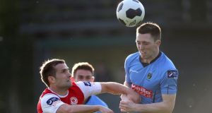 UCD's James Kavanagh battles with  Christy Fagan of St Patrick's Athletic during the Premier Division clash at the UCD Bowl. Photo: Ryan Byrne/Inpho