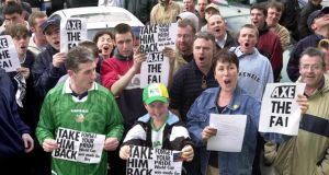 Roy Keane supporters call for the player's reinstatement as captain of the  team during a protest outside the FAI head in Merrion Square on May 28th, 2002. Photograph:  Matt Kavanagh