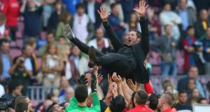Diego Simeone is thrown in the air by his Atletico Madrid  players after winning the La Liga on Saturday. Photograph: Alex Livesey/Getty Images