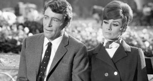 Audrey Hepburn and Peter O'Toole as a sad couple on a park bench during during location shooting in Paris for the film in new comedy 'How to Steal a Million Dollars and Live Happily Ever After'. Photograph: PA Wire.