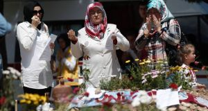 Women in Soma mourn at the graves of people who died in Tuesday's mine disaster. Turkish police have detained 19 people, including mining company executives and personnel, as part of an investigation into the disaster. Photograph: Osman Orsal/Reuters.