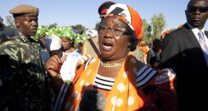 Malawian president Joyce Banda  answers journalists' questions during her final election campaign in her home village of Songani, on the outskirts of Zomba, on Saturday.  Photograph: Amos Gumulira/AFP/Getty Images