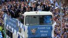 The St Johnstone team make their way through the crowds on an open top bus during the Scottish Cup winners parade in Perth. Photograph: Andrew Milligan/PA