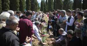 Friends and relatives of the miners who died in an explosion at the Soma mine in Turkey take part in a burial  of the last body to be recovered from the mine. Photograph: Oli Scarff/Getty Images.