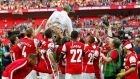 Arsenal manager Arsene Wenger  is lifted by his players as they celebrate their victory against Hull City in the FA Cup final at Wembley Stadium on Saturday. Photograph: Reuters