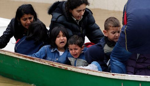Children cry as they are being evacuated by boat from a flooded house in the town of Obrenovac in Serbia. Photograph: Marko Djurica/Reuters