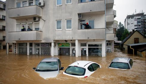 People stand in their apartments as they wait to be evacuated in the flooded town of Obrenovac, southwest of Belgrade. Photograph: Marko Djurica/Reuters