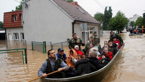 Serbian army soldiers evacuate people in a boat in the flooded town of Obrenovac, southwest of Belgrade. Photograph: Marko Djurica/Reuters