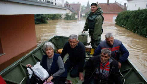 People sit in a boat after being evacuated by Serbian army soldiers from their houses in the town of Obrenovac. Photograph: Marko Djurica/Reuters