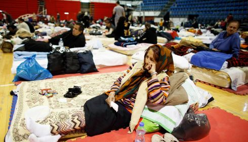 Evacuees from the Serbian town of Obrenovac take a rest on beds in a shelter hall in Belgrade. Photograph: Marko Djurica/Reuters