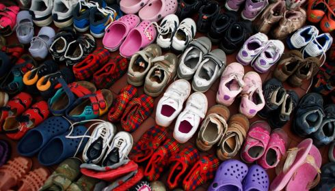 Children shoes donated to evacuated people from the Serbian town of Obrenovac are seen in a shelter hall in Belgrade. Photograph: Marko Djurica/Reuters