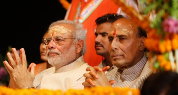 BJP leader and India's next prime minister, Narendra Modi (left), and BJP president Rajnath Singh watch evening rituals on the banks of the Ganges in Varanasi on Saturday. Photograph: AP