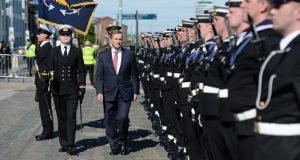 Enda Kenny inspects a guard of honour at the naming ceremony of the new Naval Service vessel LÉ Samuel Beckett on Saturday. Photograph: Dara Mac Dónaill