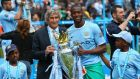 Manchester City manager Manuel Pellegrini and Yaya Toure pose with the Premier League trophy earlier this month. Photograph: Alex Livesey/Getty Images