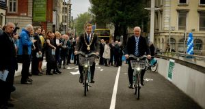 Dublin's Lord Mayor Oisín Quinn and Rosie Hackett's nephew John Grey were the first cyclists to cross the  Rosie Hackett Bridge today.  . Photograph: David Sleator/The Irish Times