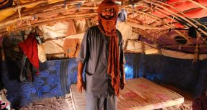 Abdullah Ould Mohammad (50) inside his shelter at the Mentao camp. Photograph: Sally Hayden