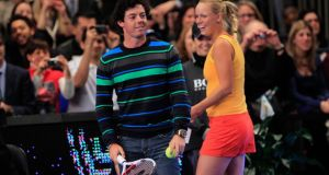 Rory McIlroy joins Caroline Wozniacki of on the court against Maria Sharapova of Russia during the BNP Paribas Showdown at Madison Square Garden on March 5th, 2012 in New York City. Photograph:  Chris Trotman/Getty Images.