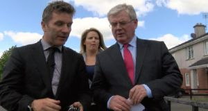 Harry McGee speaks to Eamon Gilmore as he emerges 'almost unscathed' from canvassing at a housing estate in Kinnegad.