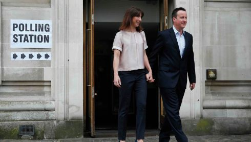 Britain's prime minister David Cameron and his wife Samantha leave after voting in the local council and European elections at a polling station in London.  Photograph: Suzanne Plunkett/Reuters