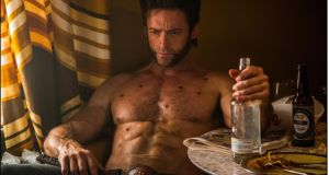 Hugh Jackman as Logan in X-Men: Days of Future Past
