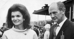 Mrs Jacqueline Kennedy with the taoiseach Mr Lynch, at the Irish Derby in the Curragh in 1967.  Saturday. Photograph: Dermot Barry / The Irish TImes