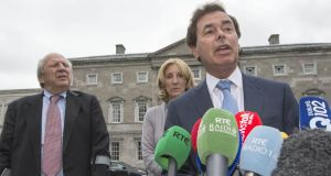 Alan Shatter flanked by Jonathan Irwin and Mary Ann O'Brien, founders of the Jack and Jill Foundation. Photograph: Brenda Fitzsimons.
