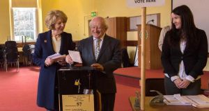 President Michael D Higgins and his wife Sabina photographed at St.Mary's Hospital Phoenix Park Dublin casting their vote in the european and local elections. Photograph: Brenda Fitzsimons/The Irish Times
