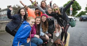 One Direction fans wait in the rain for the band to arrive at Croke Park for the first of three sold out concerts.Photograph: Brenda Fitzsimons /The Irish Times