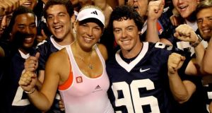 In the thick of it: Wozniacki with McIlroy shortly after they started dating, in 2011. Photograph: Matthew Stockman/Getty