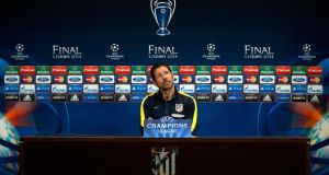 "Atletico's coach Diego ""Cholo"" Simeone ponders a question at a recent Champions League final news conference. ""It's hard for me to interact with players who don't give themselves completely. The weak don't interest me."""