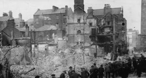 'The poll showed that even among Sinn Féin voters, who might be expected to be most suspicious about inviting a British royal to an event so central to the party's identity, there is a clear majority in favour.' Above, volunteers clearing debris in Dublin after the Easter Rising. Photograph:  Topical Press Agency/Getty Images