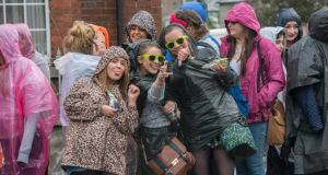 One Direction fans wait in the rain for the band to arrive at Croke Park for the first of three sold out concerts. Photograph: Brenda Fitzsimons/The Irish Times