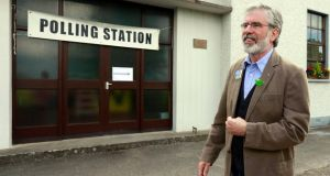 Sinn Féin president Gerry Adams leaves the polling station after casting his vote in the European parliament elections at Dulargy national school, near the the town of Dundalk, yesterday. Photograph: Cathal McNaughton/Reuters