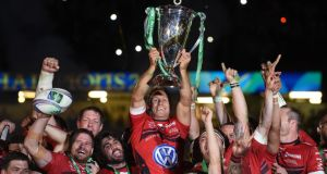 RC Toulon's Jonny Wilkinson lifts the trophy after winning the Heineken Cup Final at the Millennium Stadium in Cardiff with victory over Saracens. Photograph:  Joe Giddens/PA