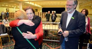 Mary-Lou McDonald greets a friend, watched by Sinn Féin leader Gerry Adams at the Dublin West byelection count in  City Wes Dublin. Photograph: Dave Meehan/The Irish Times