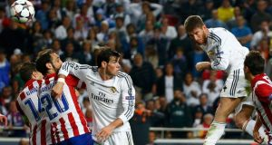 Real Madrid's Sergio Ramos rises above the Atletico Madrid defence to score  his side's equaliser  during their Champions League final  at Estadio da  Luz Stadium in Lisbon. Photograph: Michael Dalder/Reuters