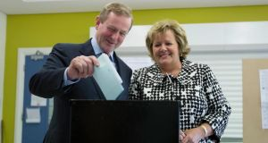 Taoiseach Enda Kenny and his wife Fionnuala voting in the Local and European election's yesterday in  his hometown of Castlebar, Co Mayo. Photograph: Keith Heneghan/The Irish Times.
