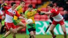 Derry's Dessie McColgan and Michael McAvoy tackle Jamie Brennan of Donegal during their Ulster  minor football championship quarter-Final at Celtic Park. Photograph: Inpho
