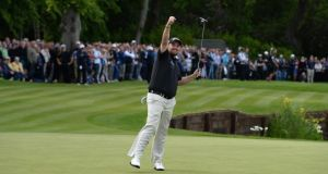 Shane Lowry celebrates holing a birdie putt on the 18th green to earn second place on his own and a cheque for €527,000 at the BMW PGA Championship at Wentworth. Photograph:  Ross Kinnaird/Getty Images