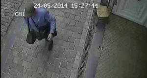 A surveillance camera image shows the suspected killer walking near the Jewish museum in Brussels on Saturday. Photograph: AP Photo/Belgian Federal Police