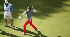Rory McIlroy  throws his ball to the crowd after holing a winning birdie putt on the 18th green on the final day  of the BMW PGA Championship at Wentworth. Photograph:  Andrew Redington/Getty Images.