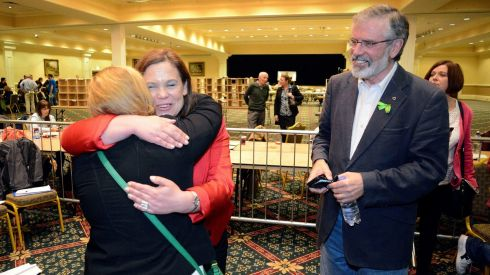 Mary-Lou McDonald greets a friend, watched by Sinn Fein leader Gerry Adams, at the Dublin West byelection count at City West. Photograph: Dave Meehan