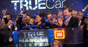 IPO celebration: TrueCar employees mark its recent IPO by ringing the opening bell at the Nasdaq Exchange in Times Square, New York.  Photograph: Andrew Burton/Getty Images