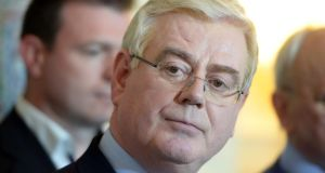 Eamon Gilmore speaking at a press conference in Iveagh House, Dublin, this afternoon, during which he announced his resignation as Labour Party leader: Photograph: Eric Luke/The Irish Times
