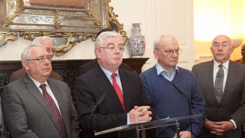 The Minister for Foreign Affairs and Tánaiste Eamon Gilmore steps down as leader of the Labour Party surrounded by party top brass in Dublin.  Photograph: Gareth Chaney/Collins
