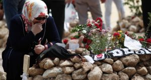 A woman mourns at the grave of a miner who died in the  Soma disaster earlier this month. Photograph: Osman Orsal/Reuters