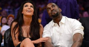 Kim Kardashian and Kanye West attending a basketball match in 2012. Their visit to Ireland is a 'global story', apparently. Photograph: Getty