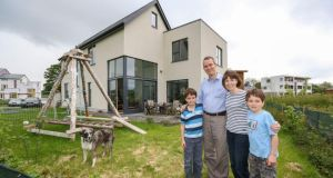 Deirdre O'Brolchain, her husband Eoin and sons Ruairí and Senan at their home in the ecovillage in Cloughjordan, Co Tipperary. Photograph: Brian Gavin/Press 22